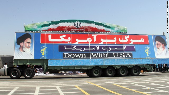 A military truck with a banner against the USA during an annual military parade which marks Iran's eight-year war with Iraq, 1980-88, in the capital Tehran, on September 22, 2013.