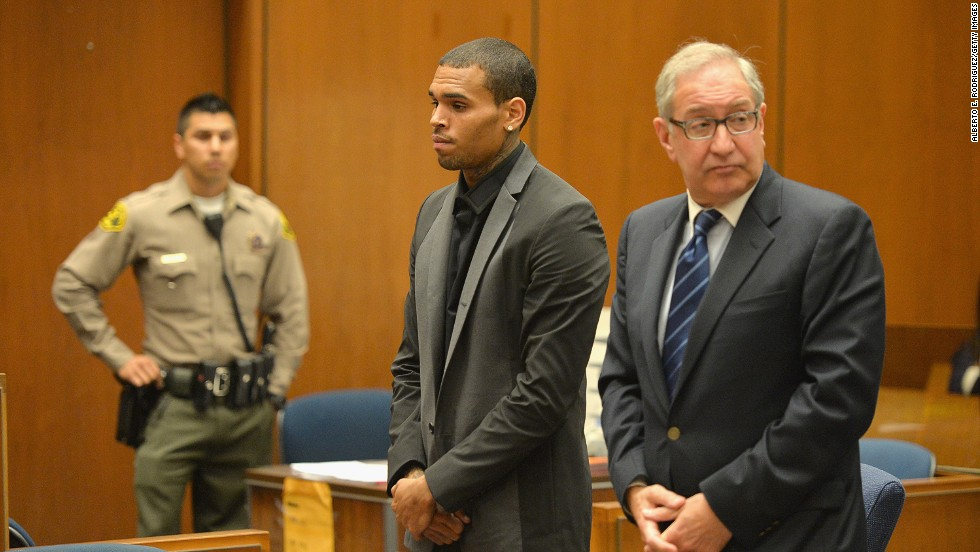 "<strong>July 2013:</strong> <a href=""http://www.cnn.com/2013/08/15/showbiz/chris-brown-court/index.html"">Brown's probation was revoked July 15</a> after he was accused of hit-and-run driving and driving without a license. A woman told investigators Brown ""went ballistic"" after a traffic accident and screamed at her. The charges were dropped after Brown reached a ""civil compromise"" with his accuser a month later. Here, he appears in court with his attorney, Mark Geragos."