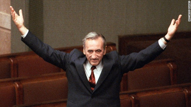 A file photo taken on September 12, 1989 shows Polish Prime Minister Tadeusz Mazowiecki triumphally saluting deputies from still empty government benches at the Parliament in Warsaw after the election of his cabinet.