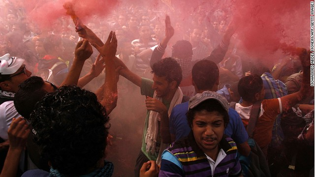 Student supporters of ousted Egyptian leader Mohamed Morsy light up a flare as they demonstrate outside al-Azhar university in Cairo on Oct. 28, 2013.