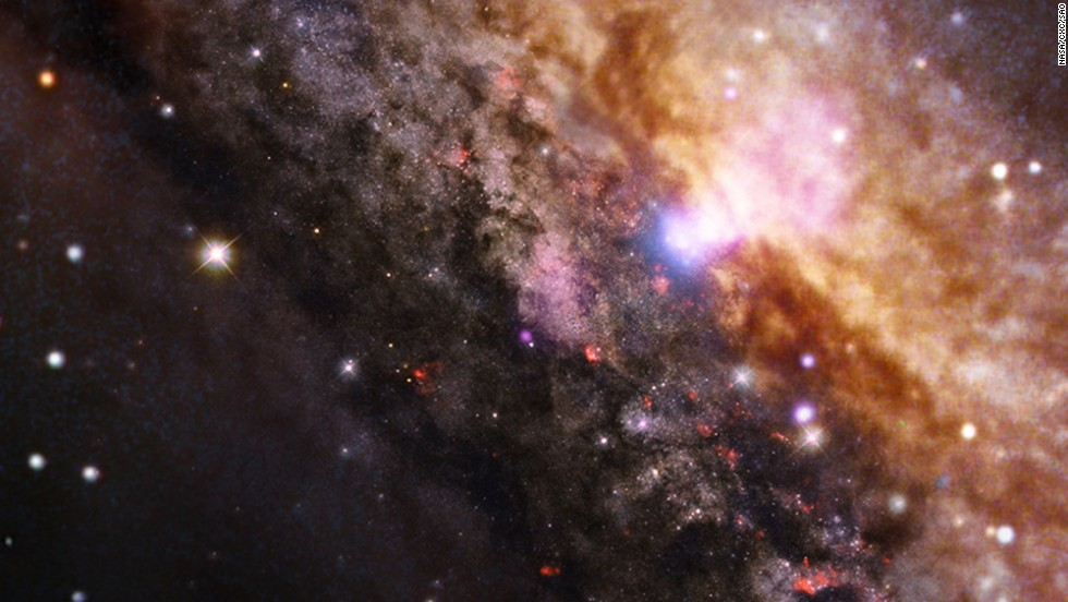 "In honor of American Archives Month, NASA has released a selection of eight <a href=""http://www.nasa.gov/mission_pages/chandra/news/xray-universe-legacy.html#.Um-9R5RVA7v"" target=""_blank"">never-before-seen images</a> from the Chandra X-ray Observatory, a telescope in space. This image is of a galaxy, NGC 4945, that is about 13 million light years away from Earth. It looks like the Milky Way, but it contains a supermassive black hole within the white area near the top of the image."