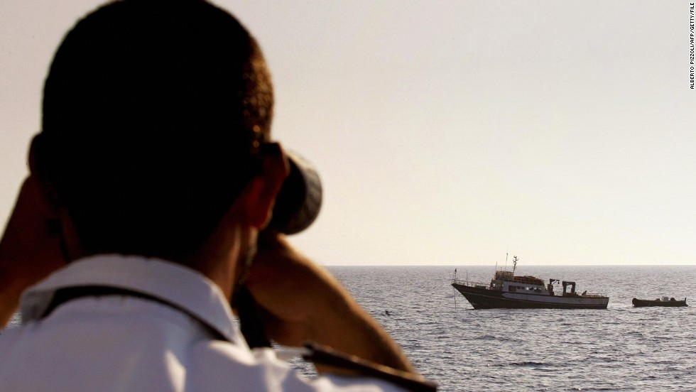 An Italian coast guard officer checks a Tunisian fishing boat in the Mediterranean.
