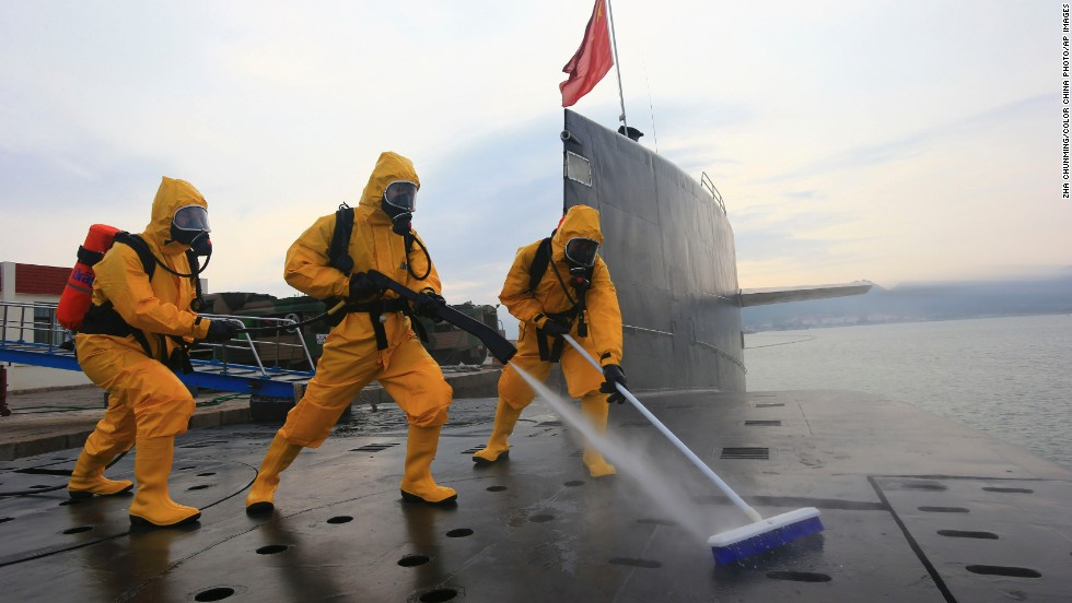 Soldiers clean and disinfect a nuclear submarine at the Qingdao submarine base in east China's Shandong province on July 17.