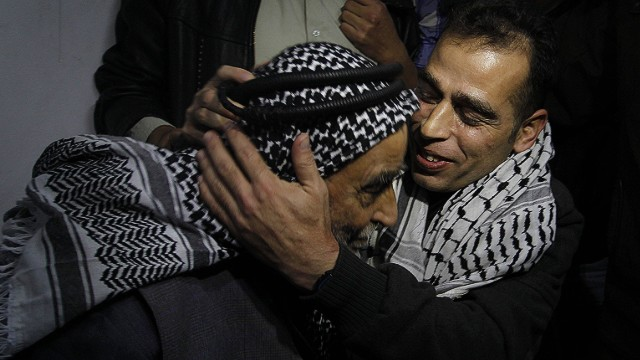 Palestinian prisoner Hazem Shubeir (R) hugs his father upon his arrival at his family home in Khan Younis in the southern Gaza Strip after his release from an Israeli jail, on October 30, 2013. Israel freed 26 veteran Palestinian prisoners in line with commitments to the US-backed peace process, but moved in tandem to ramp up settlement in annexed east Jerusalem. AFP PHOTO / SAID KHATIBSAID KHATIB/AFP/Getty Images