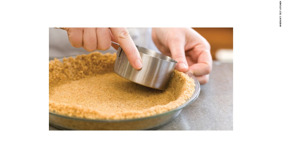 Then use a measuring cup to pack the crumb mixture tightly into the pan.