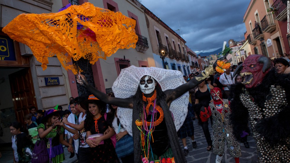 "Revelers dance through the streets in traditional costumes in Oaxaca on Wednesday, October 30. ""The first day of Dia de los Muertos is dedicated to honoring the lives of children who have passed away and adults are celebrated the next day,"" says Cano-Murillo."
