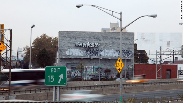 "A set of balloons that read ""BANKSY!"" tied to the side of a warehouse could be seen off the Long Island Expressway in Queens on October 31. It is likelly Banksy's final piece during his stint in New York."
