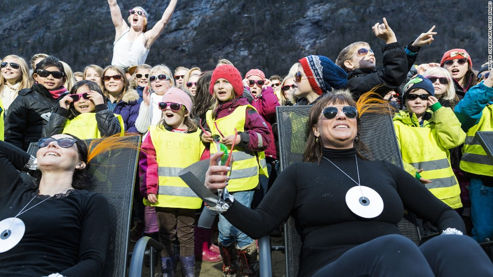 Residents and visitors lap up the sun in the market square of Rjukan in Norway. Up until this week the town -- which sits in a village -- was devoid of winter sun. That changed because...