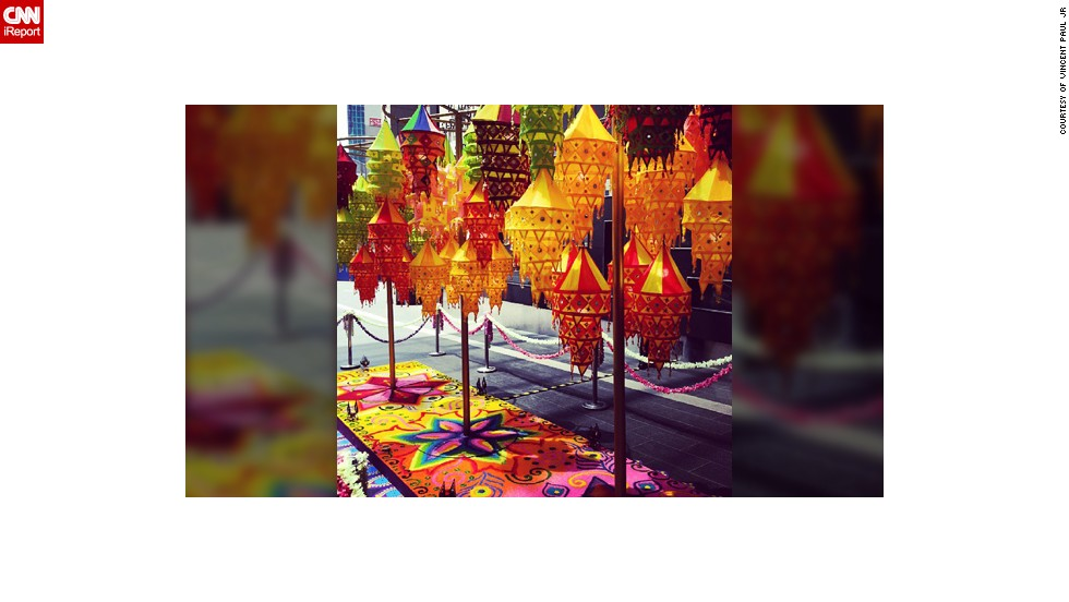 "The vibrant colors of the Diwali lanterns and a rangoli was captured by avid <a href=""http://instagram.com/parwandra"" target=""_blank"">Instagrammer Vincent Paul JR</a> a few days ago during his lunch break at a shopping mall in Kuala Lumpur, Malaysia. The 27-year-old, who teaches English at the local university, was raised as a Catholic but converted to Hinduism a few years ago. ""The lamps comply to the Hindu belief that light is a form of the divine. Rangoli is a symbol of welcome, Indians drew them on their doorsteps to invite all sorts good energy into their homes during special occasions. The rangoli is made out of edible colored rice which serves the purpose of feeding inferior beings such as rats, pigeons and ants as a form of good deed (Dharma) in the Hindu tradition,"" he said."