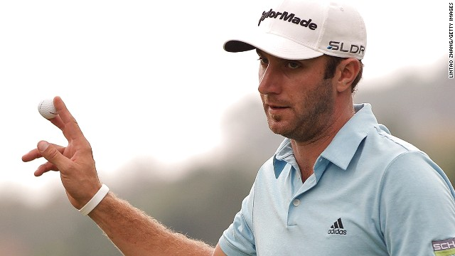Dustin Johnson acknowledges the crowd during his third round at the WGC-HSBC Champions at Sheshan International.
