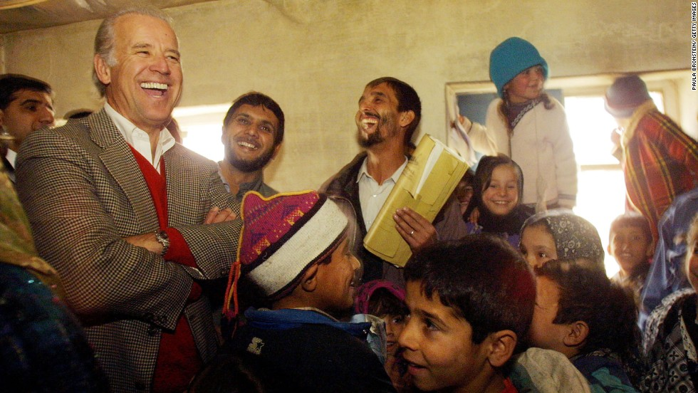 Biden, as chairman of the Senate Foreign Relations Committee, laughs with students as he visits a high school in Kabul, Afghanistan, in 2002.