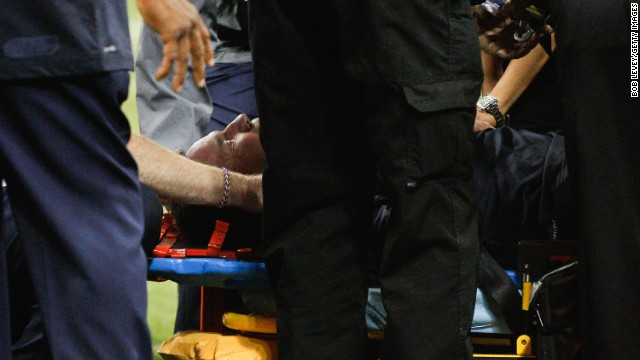 Houston Texans head coach Gary Kubiak is loaded on a stretcher after he collapsed on the field as the team left for halftime against the Indianapolis Colts at Reliant Stadium on November 3, 2013 in Houston, Texas.