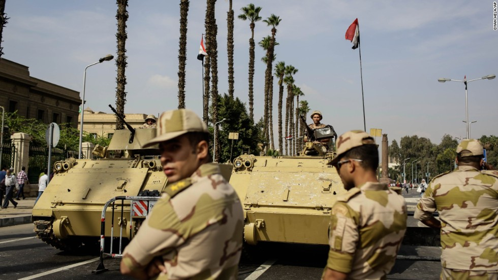 Egyptian military soldiers stand guard in Cairo the day before the trial began.