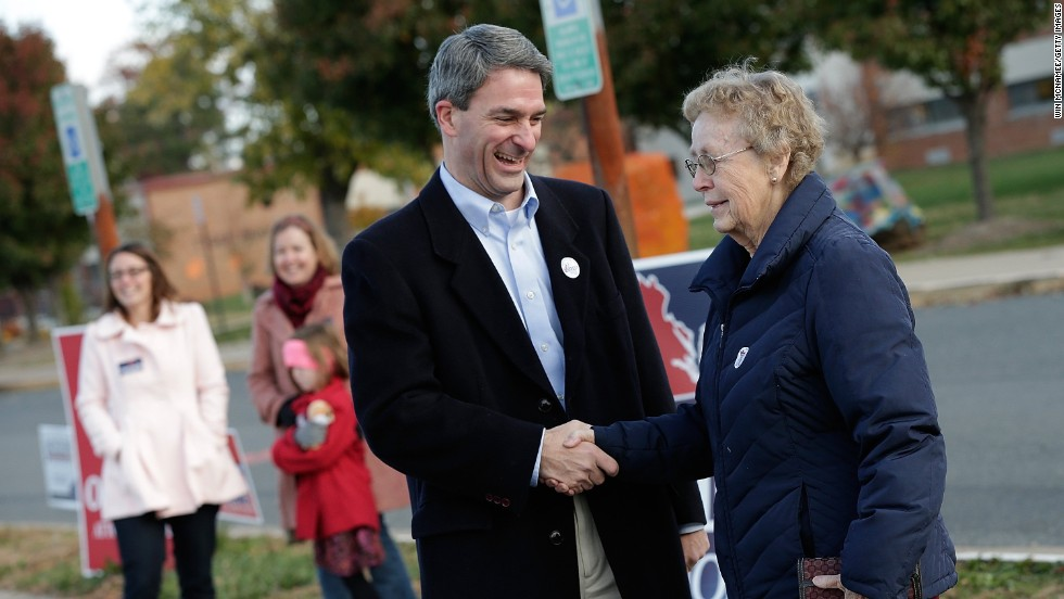 Cuccinelli greets voters after voting.
