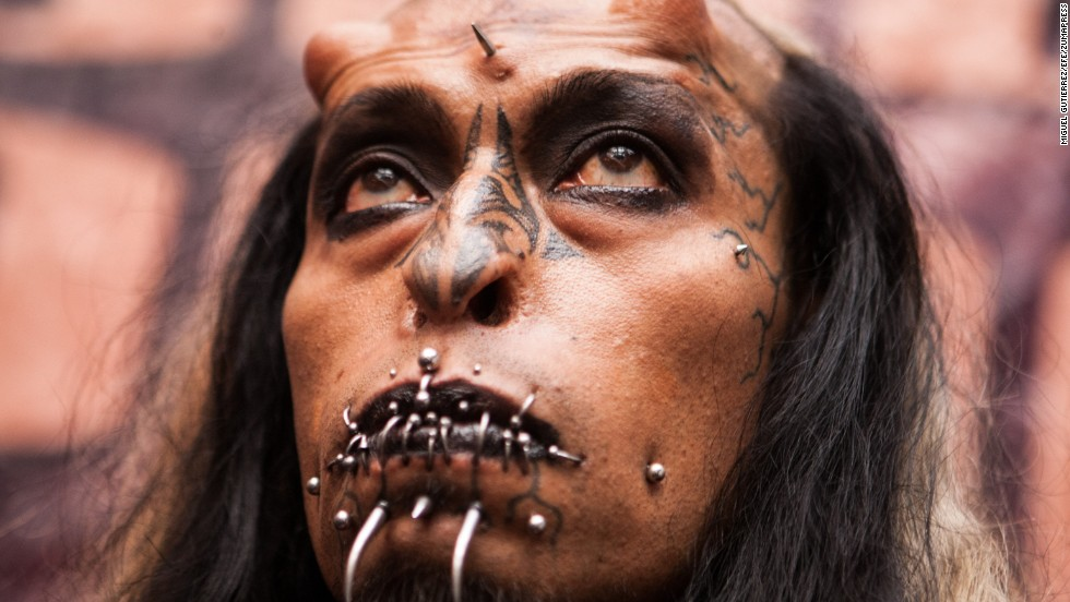 "A man at Venezuela Tattoo Expo in January appears as ""Satan,"" complete with apparent horns."