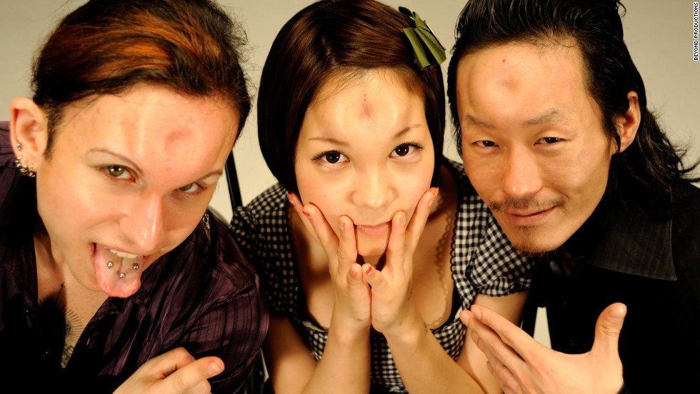 "John (left), Marin (center) and Scorpion (right) pose with their ""bagel heads"" in Tokyo."