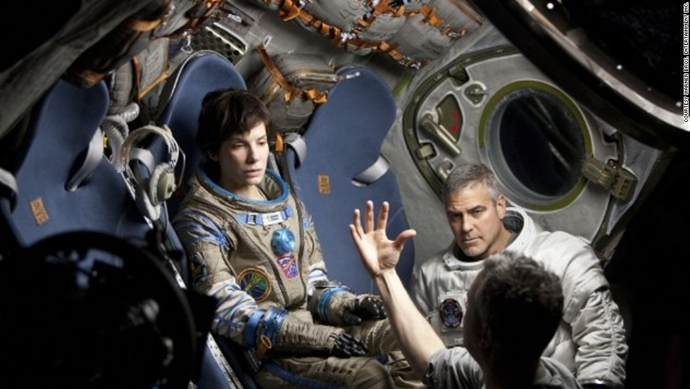 Mexican director Alfonso Cuarón (pictured on set with Bullock and Clooney) made the actors wear 12-wire harnesses, operated by puppeteers, to recreate zero-gravity. Stunning visual effects were added later.