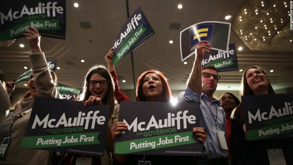 Supporters of Virginia gubernatorial candidate Terry McAuliffe attend an election night event in Tysons Corner, Virginia. McAuliffe, a former Democratic National Committee chairman, defeated Cuccinelli in the race.