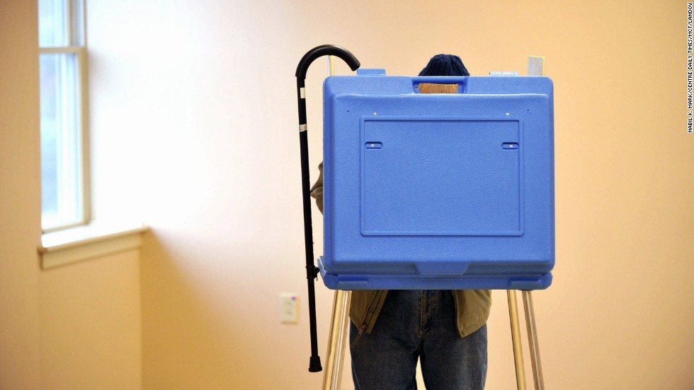 Dave Silverman, 91, hangs his cane on the booth while voting in State College, Pennsylvania.