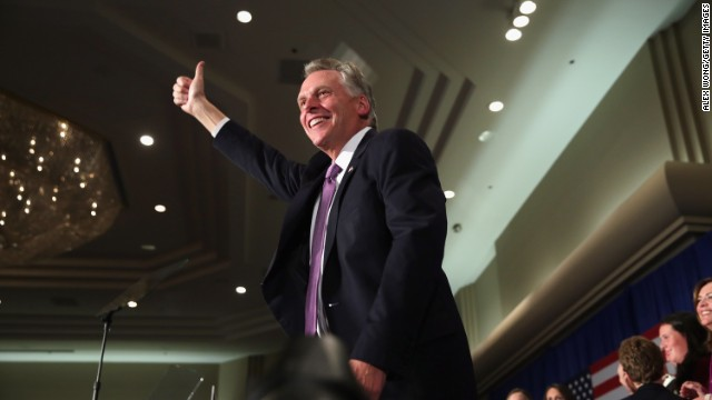 McAuliffe celebrates his win in Tysons Corner.