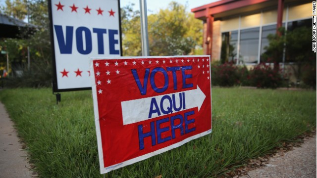 A sign points out a polling center in Austin, Texas. James Moore says the state's voter ID law hurts minorities and women.