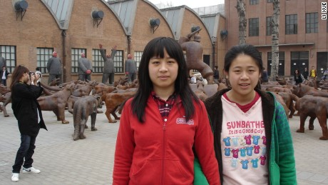 Li Xue, right, and her elder sister Li Bin. Li Xue wasn't able to go to school because she didn't have a hukou.