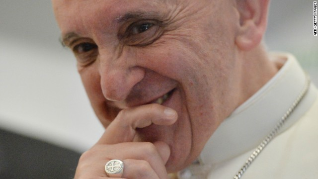 Pope Francis smiles during a long press conference held aboard the papal flight on their way back to Italy upon departure from Rio de Janeiro in Brazil, on July 28, 2013.