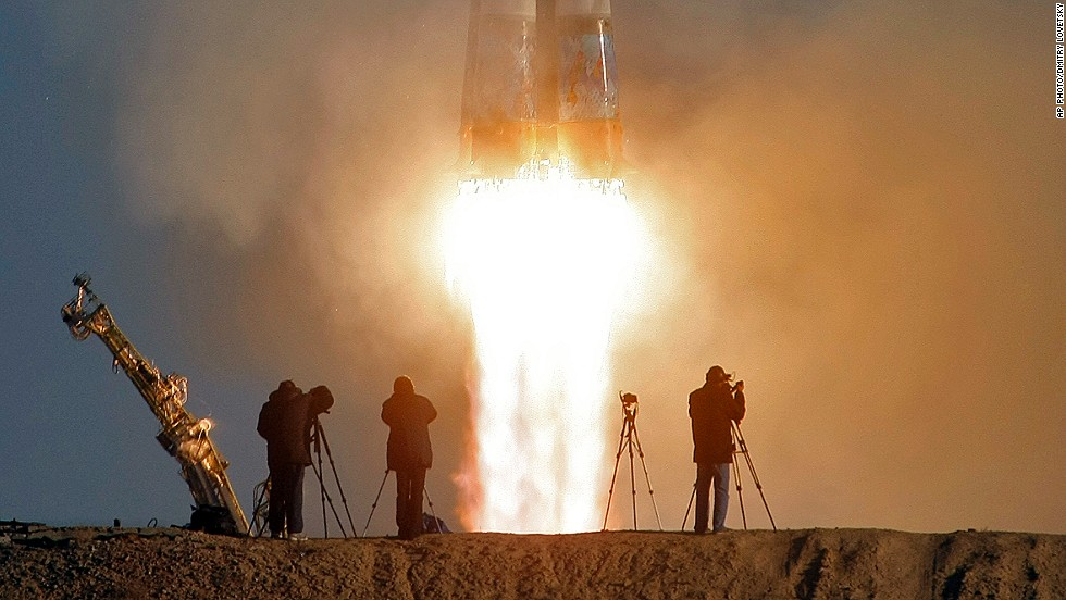 "NOVEMBER 7 - KAZAKHSTAN: Cameramen film as the <a href=""http://cnn.com/2013/11/07/worldsport/gallery/sochi-2014-winter-olympics-torch-space-sport/"">Olympic torch leaves Earth as part of its 123-day journey across Russia via the International Space Station,</a> ending at the Black Sea resort of Sochi -- host venue for the 2014 Winter Games. The rocket was launched at 8:14 a.m. local time at the Baikonur Cosmodrome, which is a Russian-leased facility."