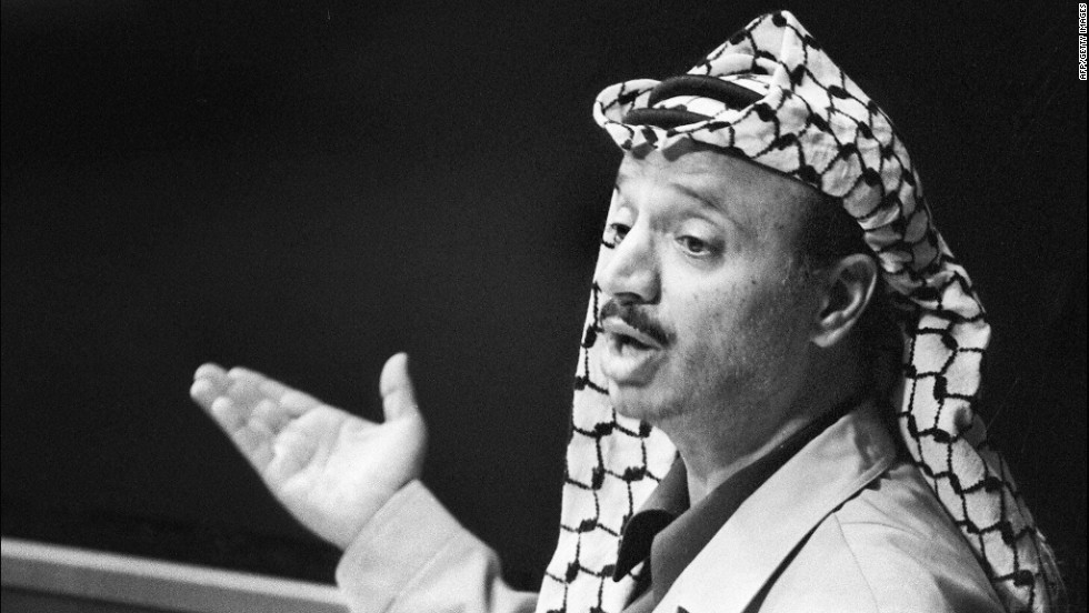 "In November 1974, Arafat addresses the General Assembly of the United Nations. ""I have come bearing an olive branch and a freedom fighter's gun,"" he was quoted as saying. ""Do not let the olive branch fall from my hand."""