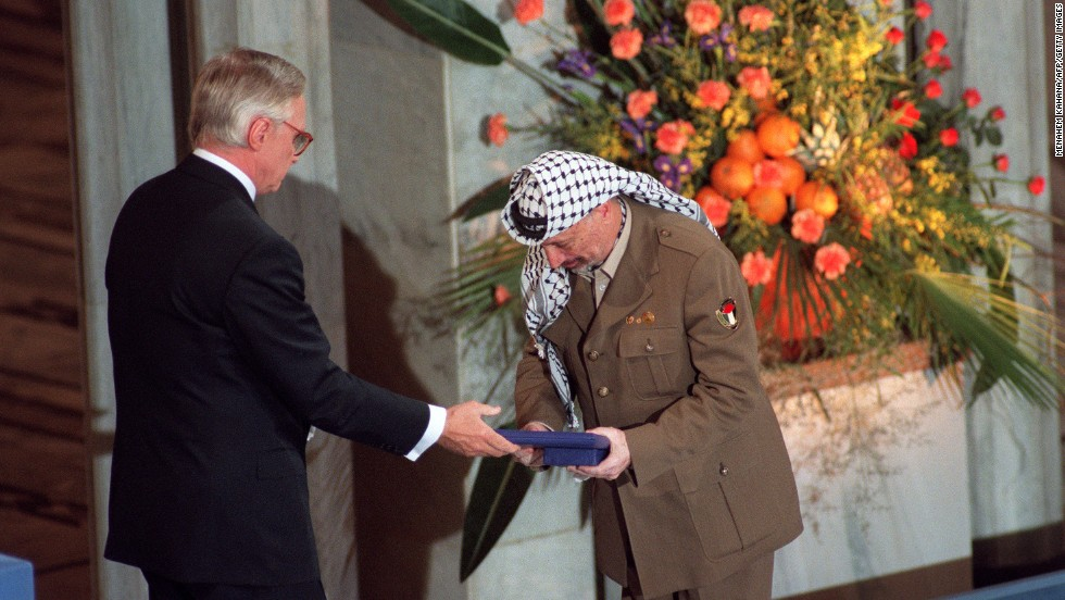 Arafat accepts the Nobel Peace Prize on December 10, 1994. He collected the prize jointly with Rabin and Israeli Foreign Minister Shimon Peres, in recognition of their historic peace accord.