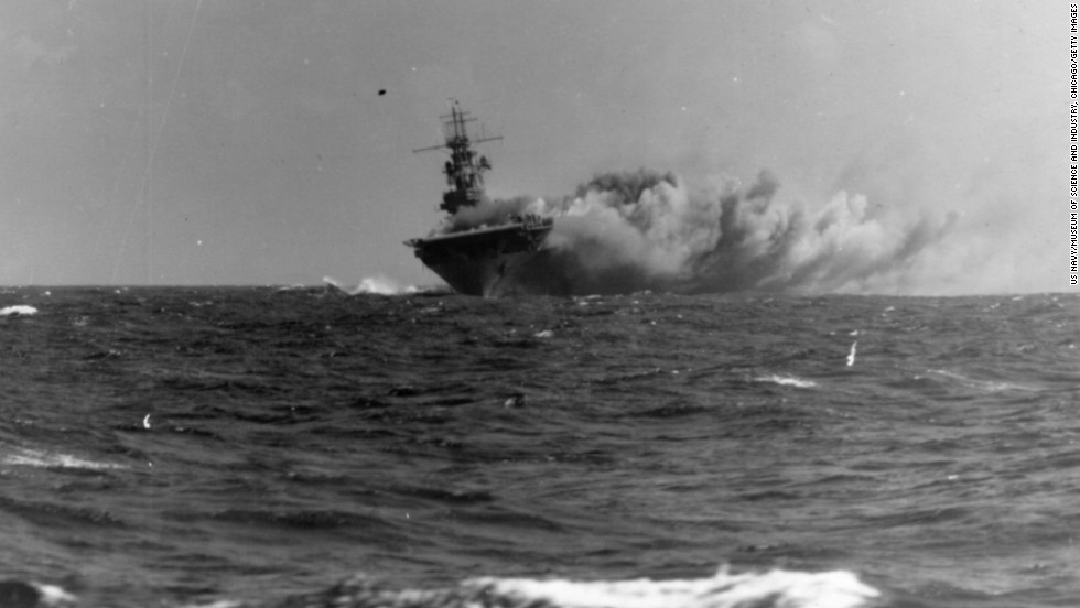 The USS Wasp burns in the Coral Sea after being struck by three torpedoes from a Japanese submarine in 1942. The ship, the only one of its class, would ultimately sink because of the damage.