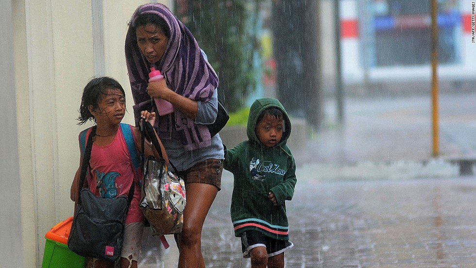 "NOVEMBER 8 - CEBU CITY, PHILIPPINES: Filipinos brave powerful winds as Typhoon Haiyan pounds the country. <a href=""http://cnn.com/2013/11/08/world/asia/philippines-typhoon-haiyan/index.html?hpt=hp_t1"">The storm is perhaps one of the strongest ever recorded on the planet.</a> It smashed into island after island across the central Philippines on Friday, threatening millions of people."