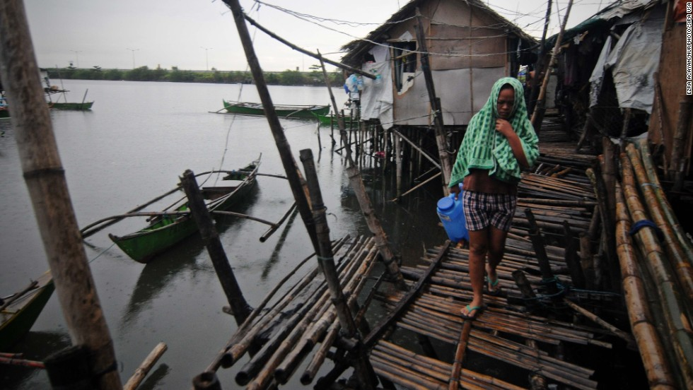 A resident walks along a fishing village in Bacoor, Philippines, on November 8.