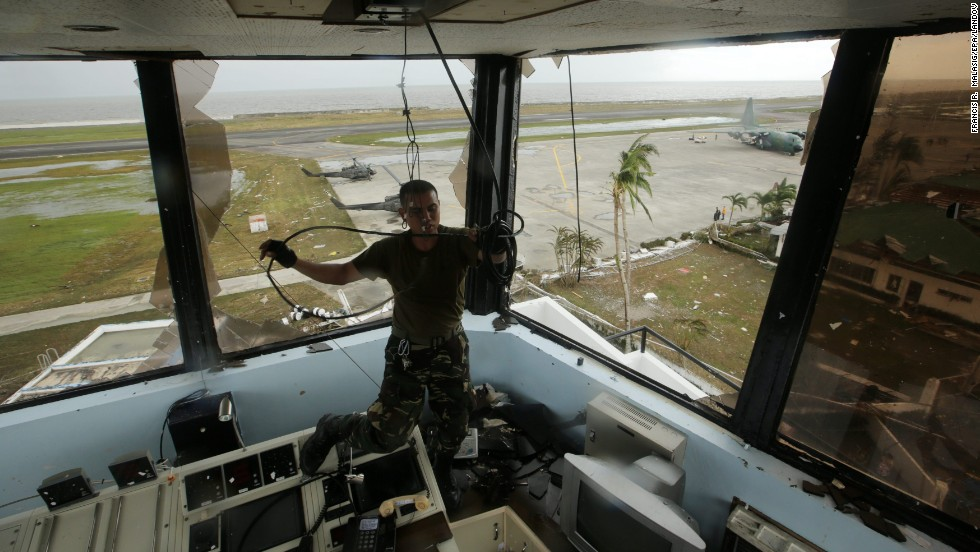 A  soldier pulls a cable inside the devastated airport tower in Tacloban.