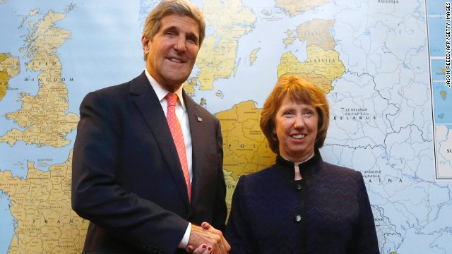 US Secretary of State John Kerry (L) shakes hands with European Union foreign policy chief Catherine Ashton before their meeting with the Iranian Foreign Minister on November 8, 2013, in Geneva, on the second day of talks with Iran on their nuclear programme. World powers and Iran have yet to reach a deal on Iran's nuclear programme but are working hard to do so, US Secretary of State John Kerry said on November 8. Kerry voiced caution at the talks, where officials have said they hope to sign a draft agreement that could see Iran freeze its nuclear programme in exchange for the easing of sanctions.  AFP PHOTO / POOL / JASON REEED