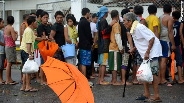 Typhoon victims queue up for relief goods in the aftermath of Super Typhoon Haiyan in Tacloban, eastern island of Leyte on November 9, 2013.