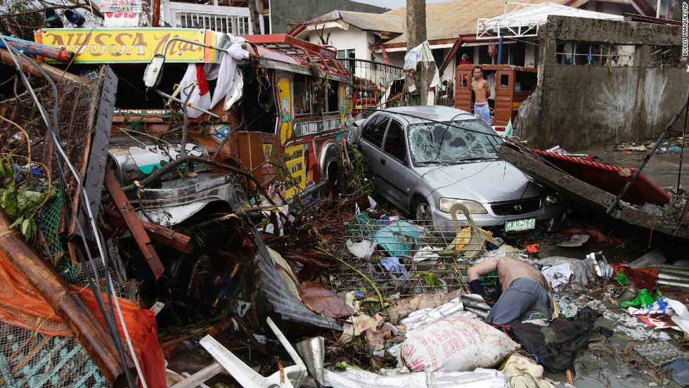 A body lies amid the Tacloban devastation on November 10.
