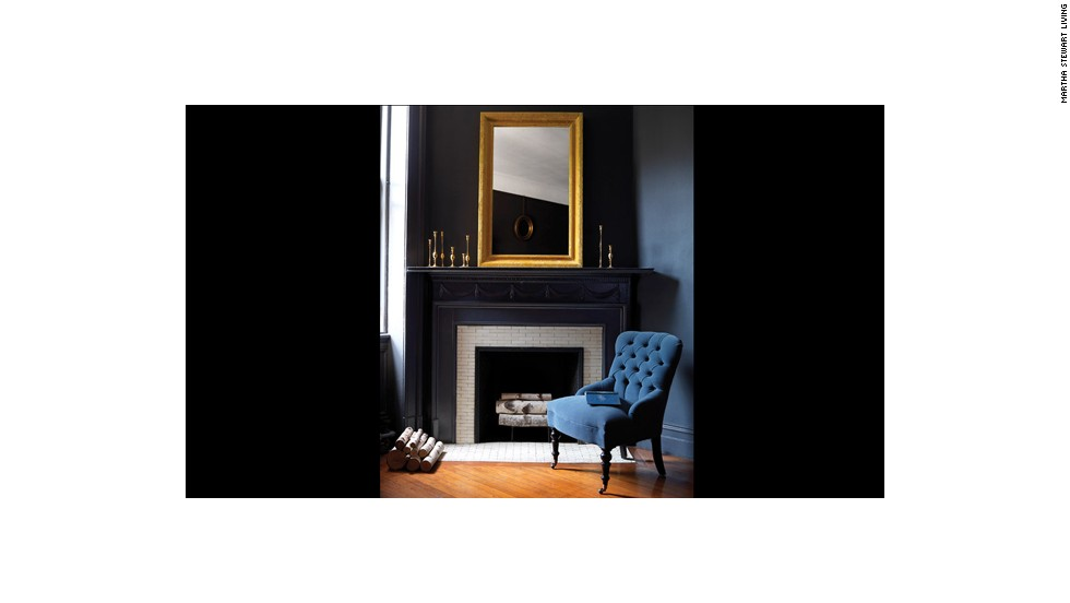 The yellow velvet frame of this mirror is striking in a luxuriously refined room.