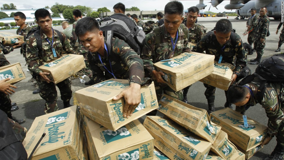 Philippine troops load boxes of water at Villamor Air Force Base in Manila on November 11.