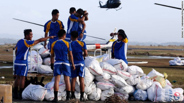Philippine Air Force personnel prepare to load relief supplies at the airport in Tacloban on November 11.