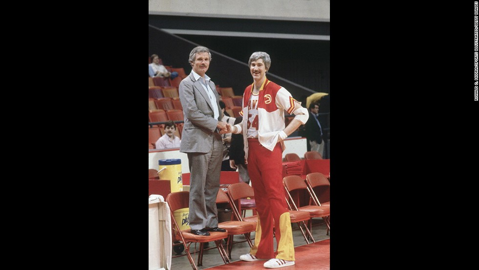 Turner stands next to Atlanta Hawks star Tom McMillen before an NBA game at the Omni Coliseum in Atlanta in March 1982. Turner bought the Hawks in the same year he won the America's Cup. It became his second professional sports team; in 1976, he had purchased the Atlanta Braves baseball team.