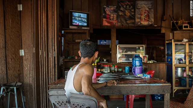 A man watches the ICJ verdict on television in Sra Em, Cambodia, near the Preah Vihear temple on November 11, 2013.
