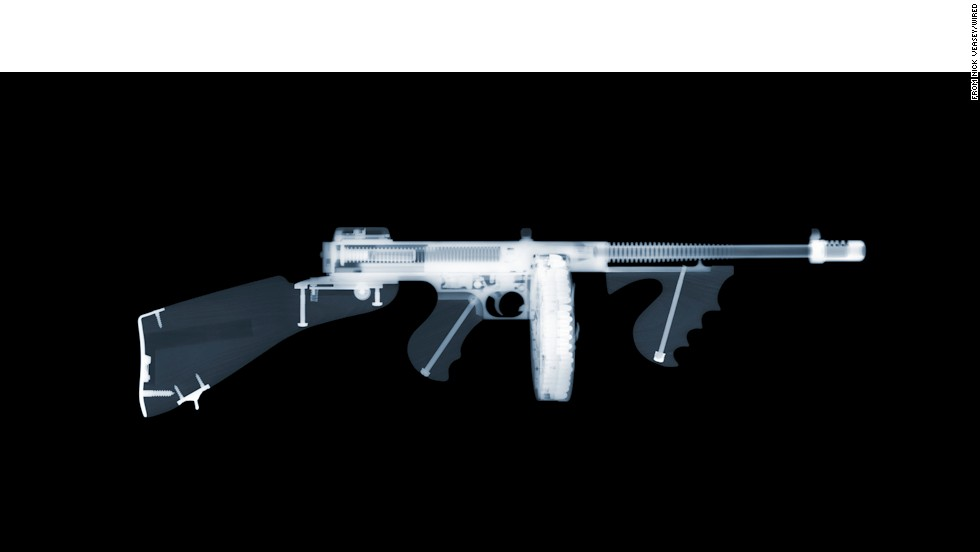British photographer Nick Veasey uses five X-ray machines in a fortified studio to capture eerie images revealing the innards of large metal objects, from cars to firearms. This photo is of a Tommy gun.