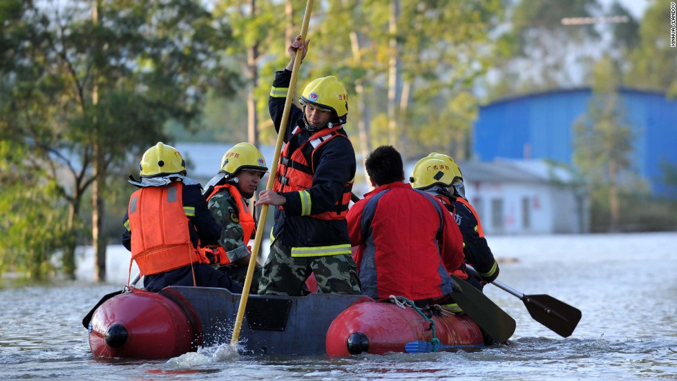 Rescuers in Guigang City, China, search a flooded road by boat on November 12. China and Vietnam were also hit hard by the typhoon.