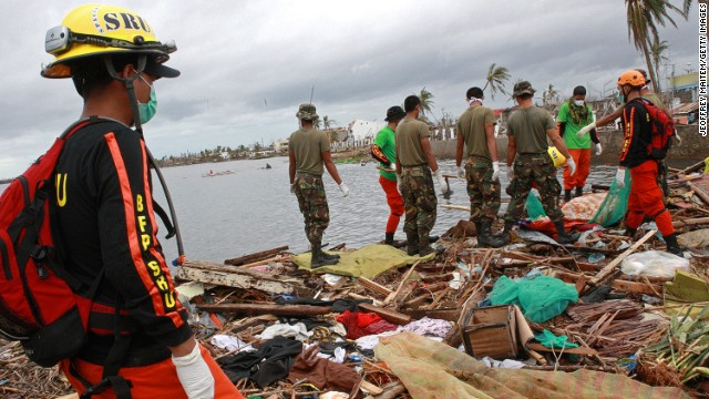 TACLOBAN, PHILIPPINES - NOVEMBER 12: Military personnel and members of the Philippine's Special Reaction Unit search for the bodies of victims of Typhoon Haiyan on November 12, 2013 near Tacloban, Leyte, Philippines. Typhoon Haiyan, packing maximum sustained winds of 195 mph (315 kph), slammed into the southern Philippines and left a trail of destruction in multiple provinces, forcing hundreds of thousands to evacuate and making travel by air and land to hard-hit provinces difficult. Around 10,000 people are feared dead in the strongest typhoon to hit the Philippines this year. (Photo by Jeoffrey Maitem/Getty Images)