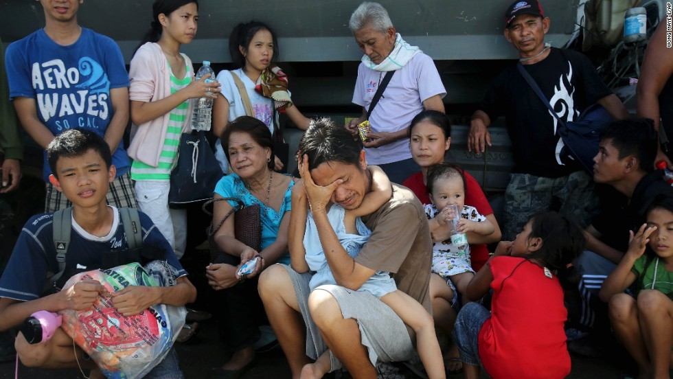 Survivors wait to be evacuated from Tacloban on November 13.