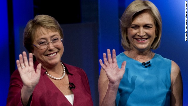 Chilean presidential candidates (L-R) Michelle Bachelet of the New Majority Coalition and Evelyn Matthei, of the right-wing Democratic Independent Union party wave during a presidential candidate debate organized by the Broadcasters Association of Chile (ANATEL) in Santiago de Chile, on October 29, 2013. Chileans go to the polls in the first round of presidential elections on November 17.