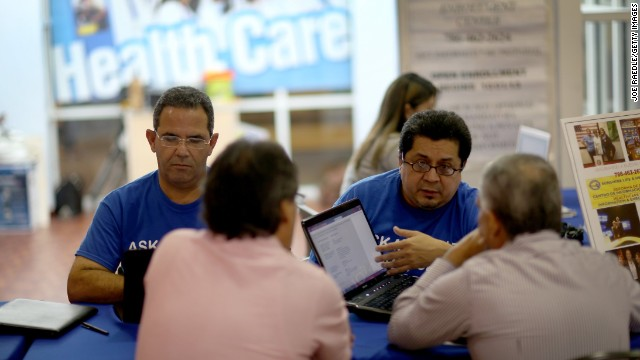 MIAMI, FL - NOVEMBER 05: Mario Ricart and Rudy Figueroa insurance agents with Sunshine Life and Health Advisors help people with information about policies that are available to them under the Affordable Care Act at a kiosk setup at the Mall of Americas on November 5, 2013 in Miami, Florida.  The insurance company was originally geared toward the Hispanic market but is expanding beyond that to specifically help people purchase and understand the policies offered under the Affordable Care Act.  (Photo by Joe Raedle/Getty Images  (Photo by Joe Raedle/Getty Images)