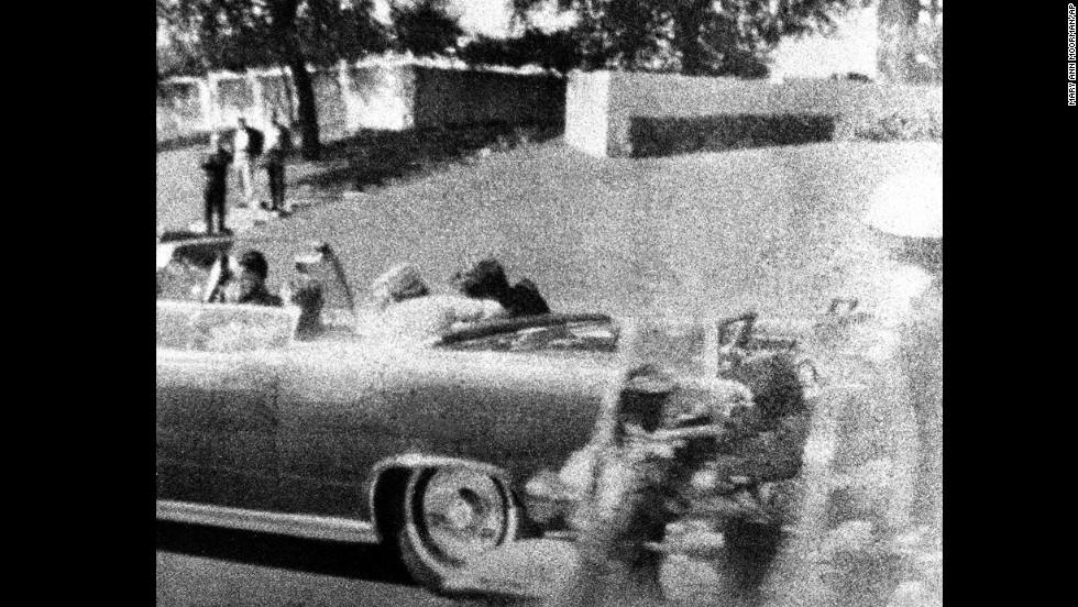 Kennedy slumps against his wife as the bullet strikes him in the head. Connally, who is wounded in the attack, begins to turn around just to the left of Jackie Kennedy.