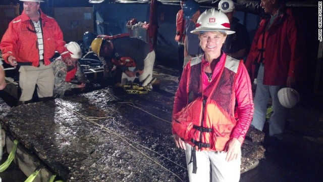 U.S. Army Corps of Engineers archaeologist Julie Morgan next to the 5,000-pound piece of the ironclad.